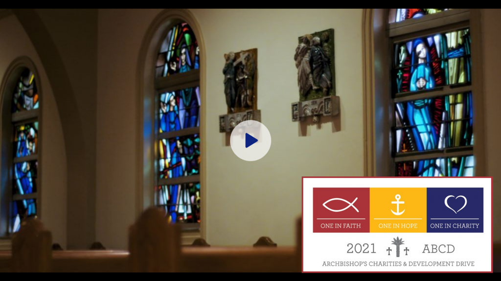 Link to ABCD video picture of stained glass window and stations of the cross and ABCD logo